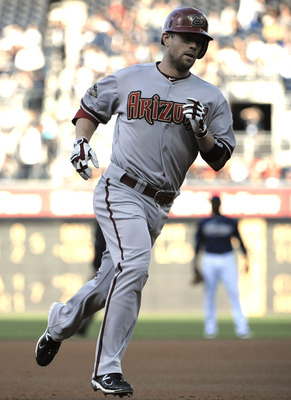 SAN DIEGO, CA - SEPTEMBER 17: Aaron Hill #2 of the Arizona Diamondbacks rounds the bases after hitting a solo home run during the first inning of a baseball game against the San Diego Padres at Petco Park on September 17, 2011 in San Diego, California. (P