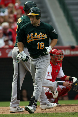 ANAHEIM, CA - SEPTEMBER 25:  Josh Willingham #16 of the Oakland Athletics jogs to the dugout after hitting a solo home run to left center field against the Los Angeles Angels of Anaheim to lead off the ninth inning at Angel Stadium of Anaheim on September