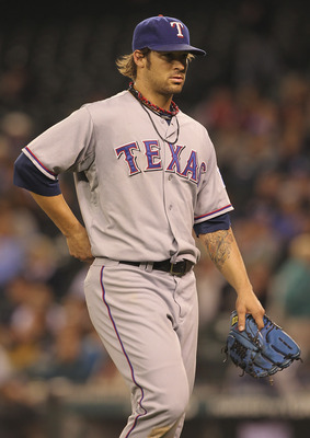 SEATTLE - SEPTEMBER 16:  Starting pitcher C.J. Wilson #36 of the Texas Rangers leaves the game in the seventh inning against the Seattle Mariners at Safeco Field on September 16, 2011 in Seattle, Washington. The Mariners defeated the Rangers 4-0. (Photo b