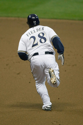 MILWAUKEE, WI - SEPTEMBER 23: Prince Fielder #28 of the Milwaukee Brewers runs after hitting a home run during the game against the Florida Marlins at Miller Park on September 23, 2011 in Milwaukee, Wisconsin. (Photo by Scott Boehm/Getty Images)