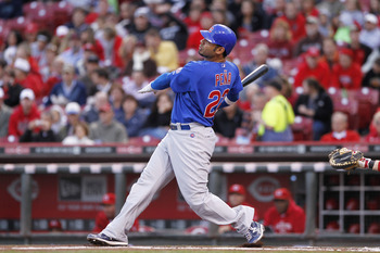CINCINNATI, OH - SEPTEMBER 15: Carlos Pena #22 of the Chicago Cubs follows through on a two-run homer in the first inning during the game against the Cincinnati Reds at Great American Ball Park on September 15, 2011 in Cincinnati, Ohio. (Photo by Joe Robb