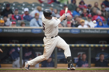 MINNEAPOLIS, MN - SEPTEMBER 18:  Michael Cuddyer #5 of the Minnesota Twins bats against the Cleveland Indians at Target Field on September 18, 2011 in Minneapolis, Minnesota.  The Indians defeated the Twins 6-5.  (Photo by Marilyn Indahl/Getty Images) Mic