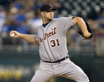 KANSAS CITY, MO - SEPTEMBER 20:   Starting pitcher Brad Penny #31 of the Detroit Tigers throws in the first inning during a game against the Kansas City Royals at Kauffman Stadium on September 20, 2011 in Kansas City, Missouri. (Photo by Ed Zurga/Getty Im
