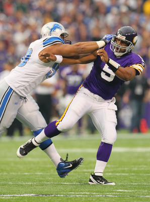 MINNEAPOLIS, MN - SEPTEMBER 25:  Donovan McNabb #5 of the Minnesota Vikings feels the hit from Ndamukong Suh #90 of the Detroit Lions after releasing the ball at the Hubert H. Humphrey Metrodome on September 25, 2011 in Minneapolis, Minnesota.  (Photo by