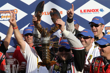 LOUDON, NH - SEPTEMBER 25:  Tony Stewart, driver of the #14 Mobil 1/Office Depot Chevrolet, celebrates in victory lane with a ceremonial winner's lobster after winning the Sylvania 300 at the New Hampshire Motor Speedway at New Hampshire Motor Speedway on