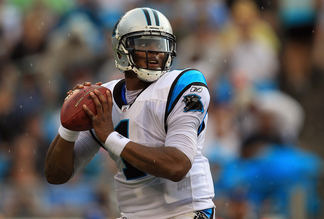 CHARLOTTE, NC - SEPTEMBER 25:  Cam Newton #1 of the Carolina Panthers throws a pass against the Jacksonville Jaguars during their game at Bank of America Stadium on September 25, 2011 in Charlotte, North Carolina.  (Photo by Streeter Lecka/Getty Images)