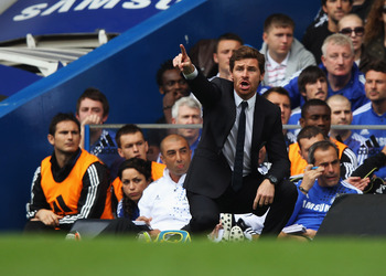 LONDON, ENGLAND - SEPTEMBER 24:  Substitute Frank Lampard and Andre Villas-Boas manager of Chelsea look on from the bench during the Barclays Premier League match between Chelsea and Swansea City at Stamford Bridge on September 24, 2011 in London, England