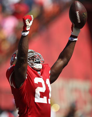 SAN FRANCISCO, CA - SEPTEMBER 18:  Frank Gore #21 of the San Francisco 49ers celebrates after scoring against the Dallas Cowboys at Candlestick Park on September 18, 2011 in San Francisco, California.  (Photo by Jed Jacobsohn/Getty Images)