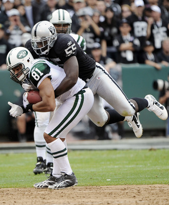 OAKLAND, CA - SEPTEMBER 25: Dustin Keller #81 of the New York Jets is tackled by Rolando McClain #55 of the Oakland Raiders in the second quarter during an NFL football game at the O.co Coliseum September 25, 2011 in Oakland, California.  (Photo by Thearo