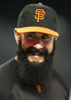 PHOENIX, AZ - SEPTEMBER 23:  Pitcher Brian Wilson #38 of the San Francisco Giants warms up before the Major League Baseball game against the Arizona Diamondbacks at Chase Field on September 23, 2011 in Phoenix, Arizona.  (Photo by Christian Petersen/Getty
