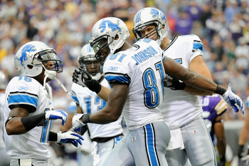 MINNEAPOLIS, MN - SEPTEMBER 25: (L-R) Titus Young #16, Calvin Johnson #81 and Tony Scheffler #85 of the Detroit Lions celebrate a touchdown by Johnson in the fourth quarter against the Minnesota Vikings on September 25, 2011 at Hubert H. Humphrey Metrodom