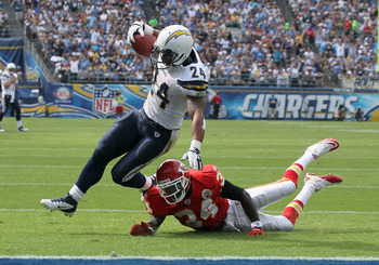 SAN DIEGO, CA - SEPTEMBER 25:  Running back Ryan Mathews #24 of  the San Diego Chargers carries the ball on a four yard touchdown carry past cornerback Travis Daniels #34 of the Kansas City Chiefs in the third quarter at Qualcomm Stadium on September 25,