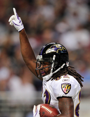 ST LOUIS, MO - SEPTEMBER 25:  Receiver Torrey Smith #82 of the Baltimore Ravens celebrates after catching a pass for a touchdown during the 1st quarter of the game against the St. Louis Rams on September 25, 2011 at the Edward Jones Dome in St Louis, Miss