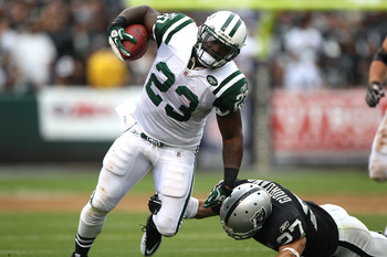 OAKLAND, CA - SEPTEMBER 25:  Shonn Greene #23 of the New York Jets runs against Chris Johnson #37 of the Oakland Raiders at O.co Coliseum on September 25, 2011 in Oakland, California.  (Photo by Jed Jacobsohn/Getty Images)