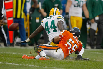 CHICAGO, IL - SEPTEMBER 25: Lance Briggs #55 of the Chicago Bears forces a fumble by James Starks #44 of the Green Bay Packers at Soldier Field on September 25, 2011 in Chicago, Illinois. The Packers defeated the Bears 27-17. (Photo by Scott Boehm/Getty I