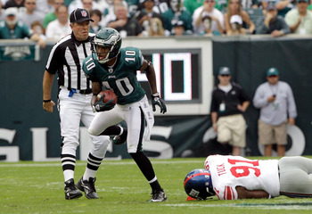 PHILADELPHIA, PA - SEPTEMBER 25:   DeSean Jackson #10 of the Philadelphia Eagles runs the ball past Justin Tuck #91 of the New York Giants during the game at Lincoln Financial Field on September 25, 2011 in Philadelphia, Pennsylvania.  (Photo by Rob Carr/