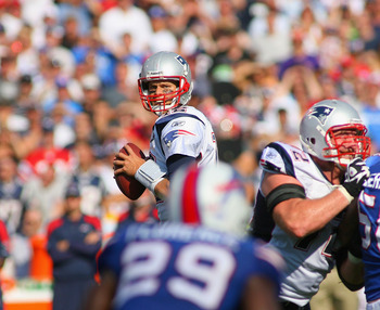 ORCHARD PARK, NY - SEPTEMBER 25: Tom Brady #12 of the New England Patriots looks to pass against the Buffalo Bills  at Ralph Wilson Stadium on September 25, 2011 in Orchard Park, New York.  Buffalo won 34-31