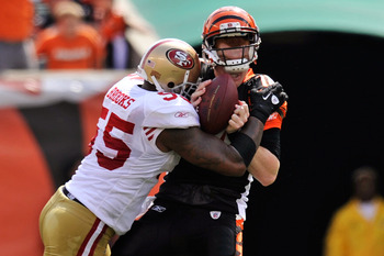 CINCINNATI, OH - SEPTEMBER 25:  Quarterback Andy Dalton #14 of the Cincinnati Bengals is sacked for a loss by Ahmad Brooks #55 of the San Francisco 49ers at Paul Brown Stadium on September 25, 2011 in Cincinnati, Ohio.  (Photo by Jamie Sabau/Getty Images)