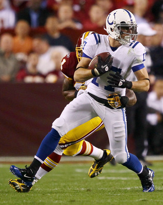 LANDOVER, MD - OCTOBER 17:  Austin Collie #17 of the Indianapolis Colts moves the ball upfield after making a reception against Kareem Moore #41 of the Washington Redskins at FedExField on October 17, 2010 in Landover, Maryland.  (Photo by Win McNamee/Get