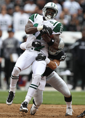 OAKLAND, CA - SEPTEMBER 25:  Plaxico Burress #17 of the New York Jets catches a passs against Stanford Routt #26 of the Oakland Raiders at O.co Coliseum on September 25, 2011 in Oakland, California.  (Photo by Jed Jacobsohn/Getty Images)
