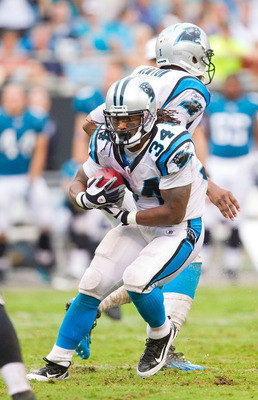 CHARLOTTE, NC - SEPTEMBER 25: DeAngelo Williams #34 of the Carolina Panthers looks for running room against the Jacksonville Jaguars at Bank of America Stadium on September 25, 2011 in Charlotte, North Carolina.  The Panthers defeated the Jaguars 16-10.