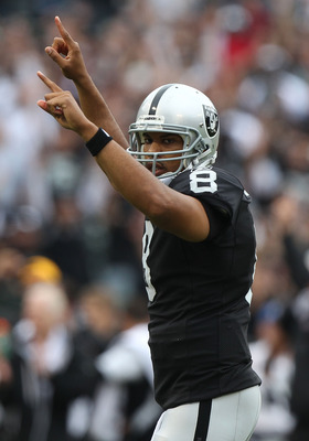 OAKLAND, CA - SEPTEMBER 25:  Jason Campbell #8 of the Oakland Raiders celebrates after a touchdown in the first half against the New York Jets at O.co Coliseum on September 25, 2011 in Oakland, California.  (Photo by Jed Jacobsohn/Getty Images)