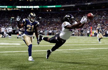 ST LOUIS, MO - SEPTEMBER 25:  Receiver Torrey Smith #82 of the Baltimore Ravens dives for a pass in the end zone as Justin King #21 of the St. Louis Rams defends during the 1st quarter of the game on September 25, 2011 at the Edward Jones Dome in St Louis