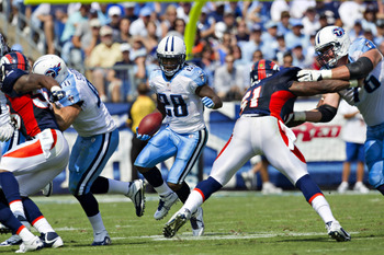 NASHVILLE, TN - SEPTEMBER 25:  Chris Johnson #28 of the Tennessee Titans runs the ball against the Denver Broncos at LP Field on September 25, 2011 in Nashville, Tennessee.   The Titans defeated the Broncos 17 - 14.  (Photo by Wesley Hitt/Getty Images)