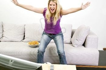 http://www.profimedia.com/photo/young-woman-cheering-in-front-of-tv/profimedia-0012881261.jpg