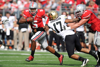 COLUMBUS, OH - SEPTEMBER 24:  Quarterback Braxton Miller #5 of the Ohio State Buckeyes can't elude the grasp of Josh Hartigan #17 of the Colorado Buffaloes in the first quarter at Ohio Stadium on September 24, 2011 in Columbus, Ohio.  (Photo by Jamie Saba