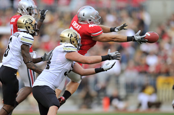 COLUMBUS, OH - SEPTEMBER 24:  Andrew Sweat #42 of the Ohio State Buckeyes breaks up a pass intended for Ryan Deehan #34 of the Colorado Buffaloes in the second half at Ohio Stadium on September 24, 2011 in Columbus, Ohio. Ohio State defeated Colorado 37-1