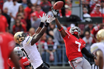 COLUMBUS, OH - SEPTEMBER 24:  Toney Clemons #17 of the Colorado Buffaloes pulls in an 11-yard touchdown catch on a fourth-and-one play over Travis Howard #7 of the Ohio State Buckeyes in the second quarter at Ohio Stadium on September 24, 2011 in Columbus