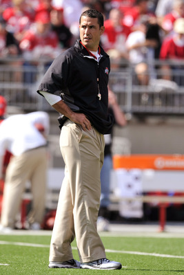 COLUMBUS, OH - SEPTEMBER 24:  Head Coach Luke Fickell of the Ohio State Buckeyes looks back at his team as they warm up before a game against the Colorado Buffaloes at Ohio Stadium on September 24, 2011 in Columbus, Ohio.  (Photo by Jamie Sabau/Getty Imag