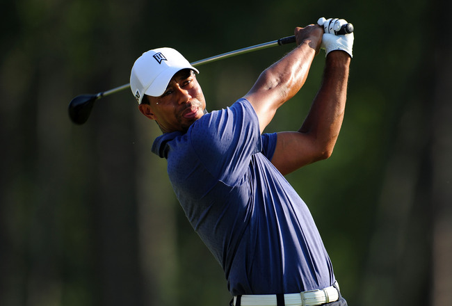 JOHNS CREEK, GA - AUGUST 12:  Tiger Woods hits a tee shot during the second round of the 93rd PGA Championship at the Atlanta Athletic Club on August 12, 2011 in Johns Creek, Georgia.  (Photo by Stuart Franklin/Getty Images)