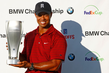 LEMONT, IL - SEPTEMBER 13:  Tiger Woods poses with the trophy after his eight-stroke victory at the BMW Championship held at Cog Hill Golf &amp; CC on September 13, 2009 in Lemont, Illinois.  (Photo by Scott Halleran/Getty Images)