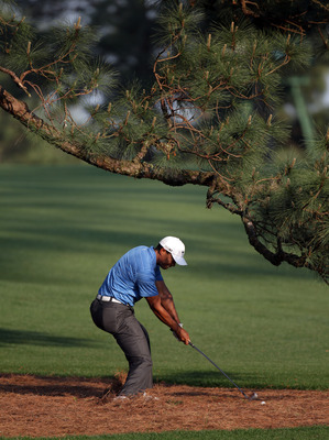 AUGUSTA, GA - APRIL 09:  Tiger Woods of the USA plays his second shot on the 17th hole from under The Eisenhower Tree during the third round of the 2011 Masters Tournament at Augusta National Golf Club on April 9, 2011 in Augusta, Georgia.  (Photo by Ross
