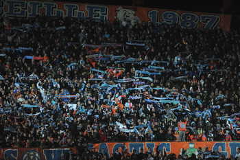 MARSEILLE, FRANCE - FEBRUARY 23: A general view of Marseille fans during the UEFA Champions League round of 16 first leg match between Marseille and Manchester United at the Stade Velodrome on February 23, 2011 in Marseille, France.  (Photo by Michael Reg