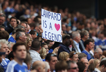 LONDON, ENGLAND - SEPTEMBER 24:  A fan holds a banner supporting Frank Lampard of Chelsea prior to the Barclays Premier League match between Chelsea and Swansea City at Stamford Bridge on September 24, 2011 in London, England.  (Photo by Clive Rose/Getty