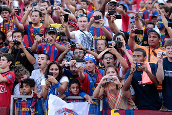 LANDOVER, MD - JULY 30: Fans cheer before the start of the  Manchester United and Barcelona friendly match at FedExField on July 30, 2011 in Landover, Maryland.  (Photo by Rob Carr/Getty Images)
