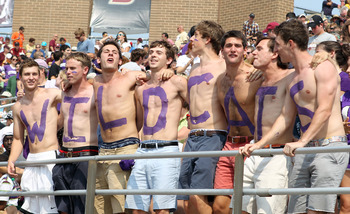 CHESTNUT HILL, MA - SEPTEMBER 03:  Northwestern Wildcats fans celebrate a touchdown against the Boston College Eagles on September 3, 2011 at Alumni Stadium in Chestnut Hill, Massachusetts.The Northwestern Wildcats defeated the Boston College Eagles 24-17