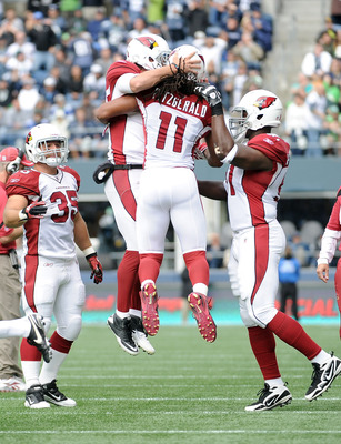 SEATTLE, WA - SEPTEMBER 25:   Larry Fitzgerald #11 and  Kevin Kolb #4 of the Arizona Cardinals celebrate a touchdown for a 10-3 lead over the Seattle Seahawks during the second quarter at CenturyLink Field on September 25, 2011 in Seattle, Washington.  (P