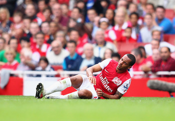 LONDON, ENGLAND - SEPTEMBER 24:  Theo Walcott of Arsenal falls down with an injury during the Barclays Premier League match between Arsenal and Bolton Wanderers at Emirates Stadium on September 24, 2011 in London, England.  (Photo by Clive Mason/Getty Ima