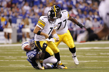 INDIANAPOLIS, IN - SEPTEMBER 25: Robert Mathis #98 of the Indianapolis Colts causes a fumble by Ben Roethlisberger #7 of the Pittsburgh Steelers in the first half of their game at Lucas Oil Stadium on September 25, 2011 in Indianapolis, Indiana. (Photo by