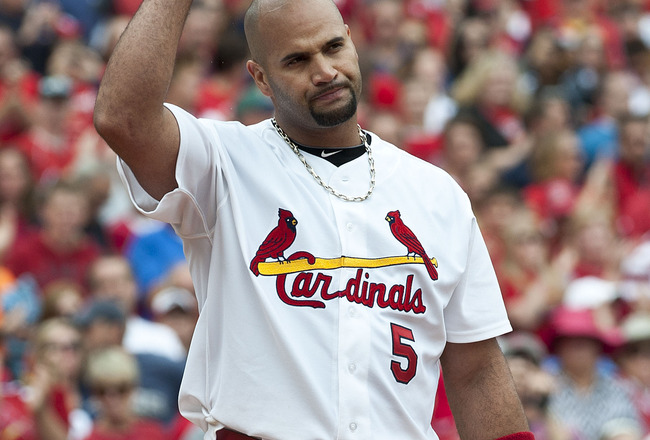 ST. LOUIS, MO - SEPTEMBER 25: First baseman Albert Pujols #5 of the St. Louis Cardinals tips his hat to the roaring St. Louis crowd on September 25, 2011 at Busch Stadium in St Louis, MO. (Photo by Ed Szczepanski/Getty Images)