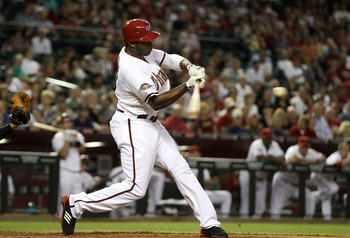 PHOENIX, AZ - SEPTEMBER 19:  Justin Upton #10 of the Arizona Diamondbacks hits a solo home run against the Pittsburgh Pirates during the sixth inning of the Major League Baseball game at Chase Field on September 19, 2011 in Phoenix, Arizona.  The Diamondb