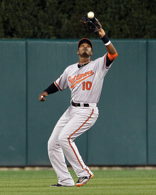 DETROIT, MI - SEPTEMBER 24:  Adam Jones #10 of the Baltimore Orioles catches the ball in center field against the Detroit Tigers during a MLB game at Comerica Park on September 24, 2011 in Detroit, Michigan. The Orioles won 6-5.  (Photo by Dave Reginek/Ge