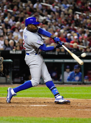 ST. LOUIS, MO - SEPTEMBER 23: Alfonso Soriano #12 of the Chicago Cubs hits a three-run home run against the St. Louis Cardinals at Busch Stadium on September 23, 2011 in St. Louis, Missouri.  (Photo by Jeff Curry/Getty Images)