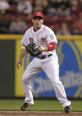 CINCINNATI, OH - SEPTEMBER 20: Joey Votto #19 of the Cincinnati Reds fields a ball against the Houston Astros at Great American Ball Park on September 20, 2011 in Cincinnati, Ohio.  (Photo by John Sommers II/Getty Images)