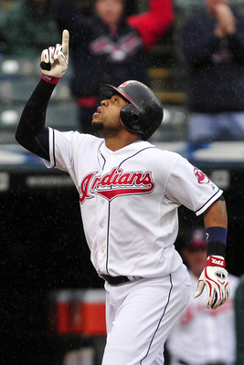 CLEVELAND, OH - SEPTEMBER 19: Carlos Santana #41 of the Cleveland Indians celebrates after hitting a solo home run during the first inning against the Seattle Mariners at Progressive Field on September 19, 2011 in Cleveland, Ohio.  (Photo by Jason Miller/