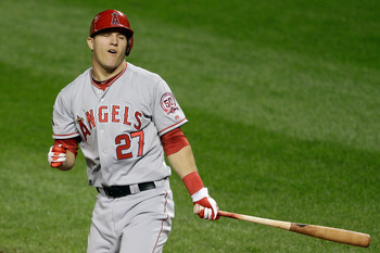 BALTIMORE, MD - SEPTEMBER 16: Mike Trout #27 of the Los Angeles Angels of Anaheim reacts after striking out swinging for the final out against the Baltimore Orioles during their 8-3 loss at Oriole Park at Camden Yards on September 16, 2011 in Baltimore, M